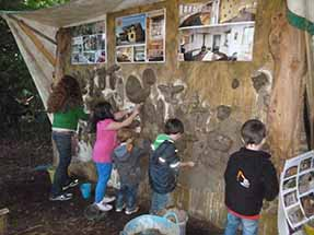 mud sculpting at the secret village
