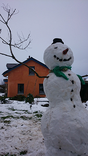 snowman at the mud and wood house